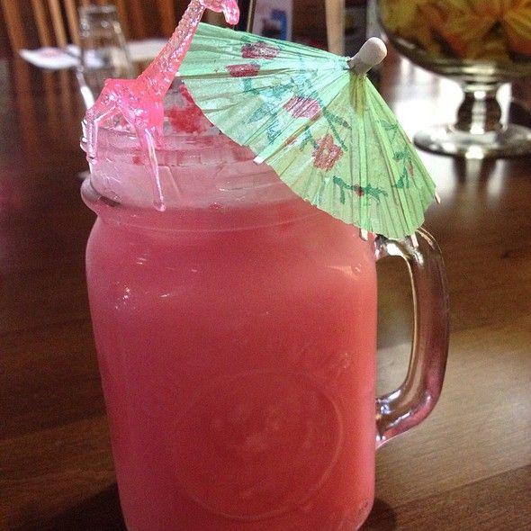 Pink Panther Alcohol Drink - 1 cup crushed ice 1 fluid ounce amaretto liqueur 1 fluid ounce vodka 8 fluid ounces pineapple juice 1 teaspoon grenadine syrup 1 slice fresh pineapple 1 maraschino cherry