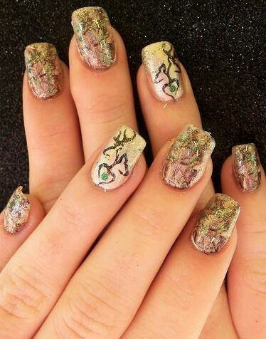 Camo nails. Not to sure about the full camo nails maybe do just the tips in the camo or in green but a most definitely to the ring finger design!!!!