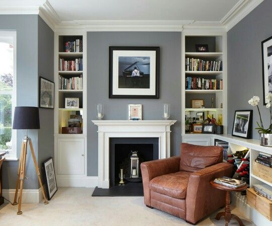 Beautiful grey wall colour and fireplace.