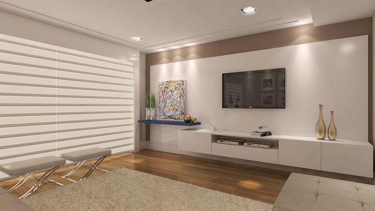 A composição na sala de tevê está impecável, veja como a laca azul se destaca e quebra um pouco o tom branco do móvel. Fonte: Arquivo Pessoal.