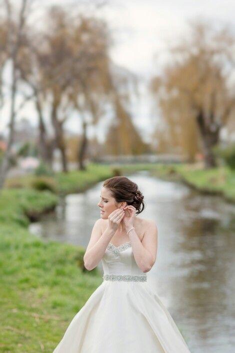 Final preparations by the river | Christchurch Wedding Photographer Mandy Caldwell Http://mandycaldwell.co.nz