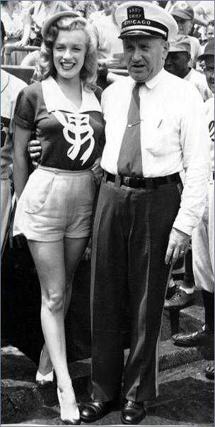 """Marilyn at Wrigley Stadium in Chicago for a pro-celeb baseball match during the """"Love Happy"""" tour, 1949."""