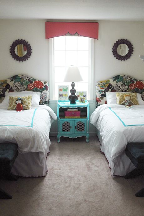 Charming children's room with  Chiangmai upholstered headboards, turquoise, and coral.