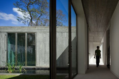 These two stark concrete houses in Lisbon were designed by Bak Gordon to replace industrial sheds.
