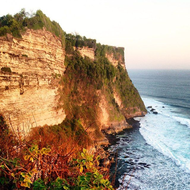Rough cliffs just next to the Uluwatu Temple. Best time to come here is for sunset as you will have an incredible view over the ocean and of course over the temple and cliffs