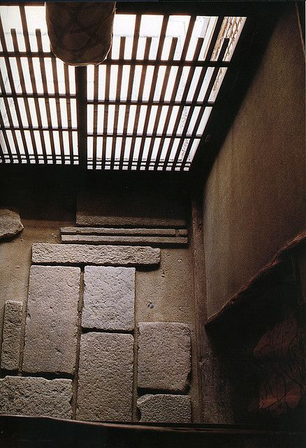 This is an example of a traditional genkan--the entryway to a Japanese home. Shoes do not go past this point. My in-laws just have simple tile in their genkan.