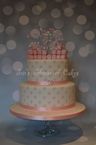 Heart studded wedding cake with baby blocks and heart spray