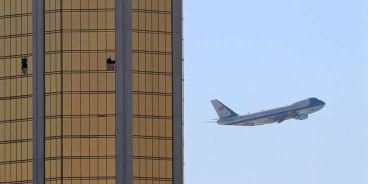 A chilling photo following Trump's trip to Las Vegas showed Air Force One flying past the broken windows on the Mandalay Bay Resort and Casino.
