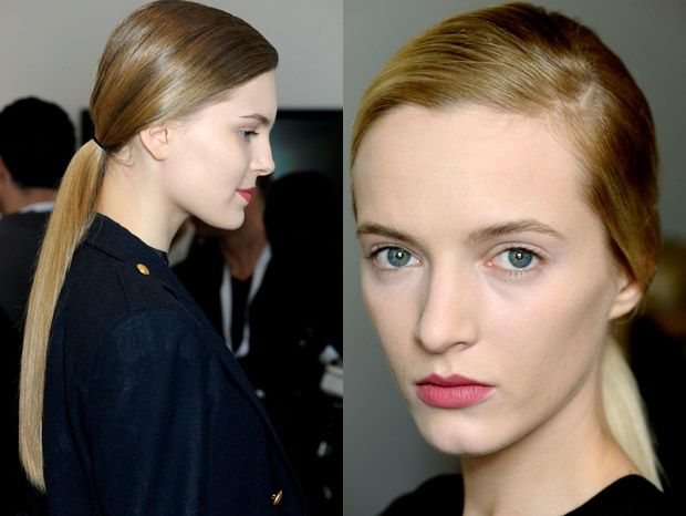Ponytails for Fall 2012  Pull The Sides Of Your Hair Over Your Ears: The antithesis of sporty, the 'elegant, womanly, and very Hitchcock-like' ponytail Guido Palau (Redken Creative Consultant and lead hairstylist) created at Jil Sander was made a bit more mature by brushing the hair down and back in a way that left only the earlobes visible—perfect for showing off your earrings.