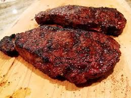 Steak Marinade 1/4 cp balsamic vinegar 1/4 cp soy sauce 3 tbsp minced garlic 2 tbsp honey 2 tbsp olive oil 2 tsp ground black pepper 1 tsp Worcestershire sauce 1 tsp onion powder 1/2 tsp salt 1/2 tsp liquid smoke flavoring 1/8 tsp cayenne pepper 2 (1/2 pound) rib-eye steaks Marinate in the refrigerator for 6 to 8 hours. Grill steaks 7 minutes per side,