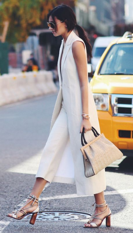 Sleeveless coats + Danielle Bernstein + white number + neutral outfit + white culottes + beige straw bag + cream sandals.   Brands Not Specified.