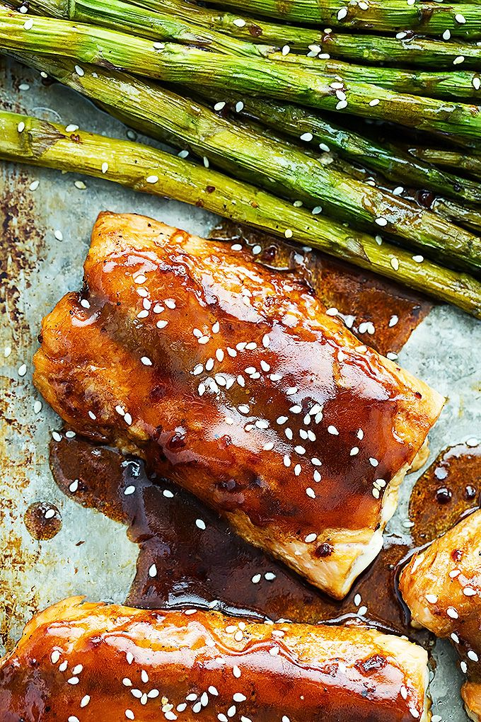 """Easy oven baked salmon and asparagus with a sweet and savory sesame glaze. Are you a fish person? I don't like """"fishy"""" fish – the kind that you can smell a mile away and tastes like the water it came from (hello lake trout) unless it is cooked in some really spectacular way that takes... Read More »"""