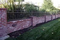 Brick and wrought iron fence