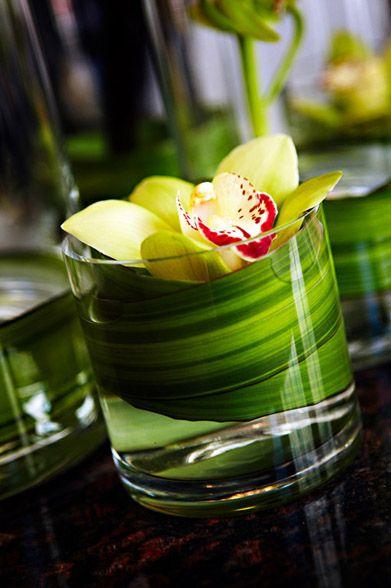 Simply elegant green orchid wedding reception centerpiece for a tropical Hawaiian themed wedding.