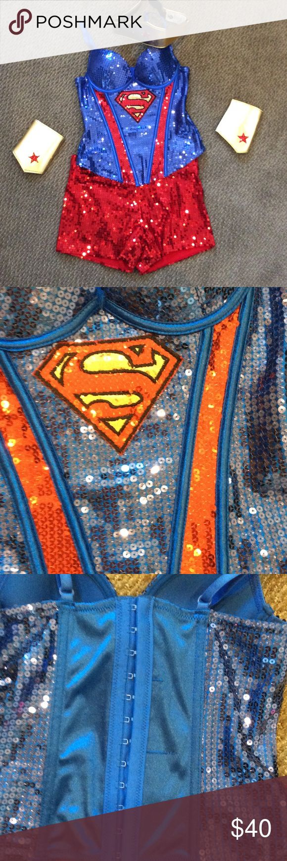 Super woman costume Blue and red sequin costume includes bustier,shorts 2 wrist bands and a headband Other