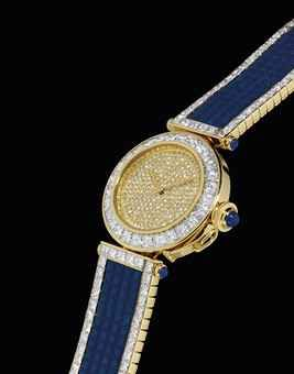 CARTIER. A VERY IMPRESSIVE AND RARE 18K GOLD, DIAMOND AND SAPPHIRE-SET AUTOMATIC BRACELET WATCH | SIGNED CARTIER, PASHA MODEL, NO. 1, CIRCA 2000