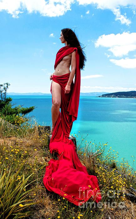 Playing with red fabric at waitawa park, auckland, new zealand