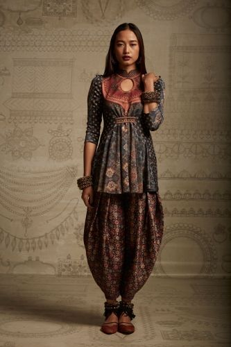 I tried to find the model's name and had no luck. But if you're curious, this is from Tarun Tahiliani of Amrita Sher-gil's 2014/2015 fall/winter collection, according to Elle India