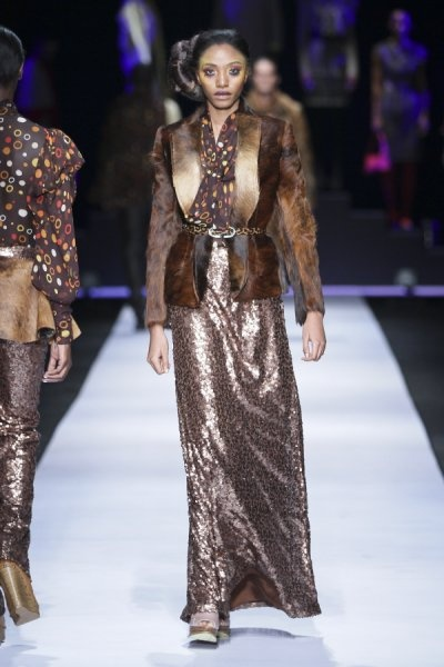 #DTCouture. Animal hyde waistcoat with sequenced skirt.