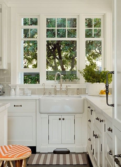 Dutch colonial revival traditional kitchen design with kitchen sink window  view. Scavullo Design Interiors,