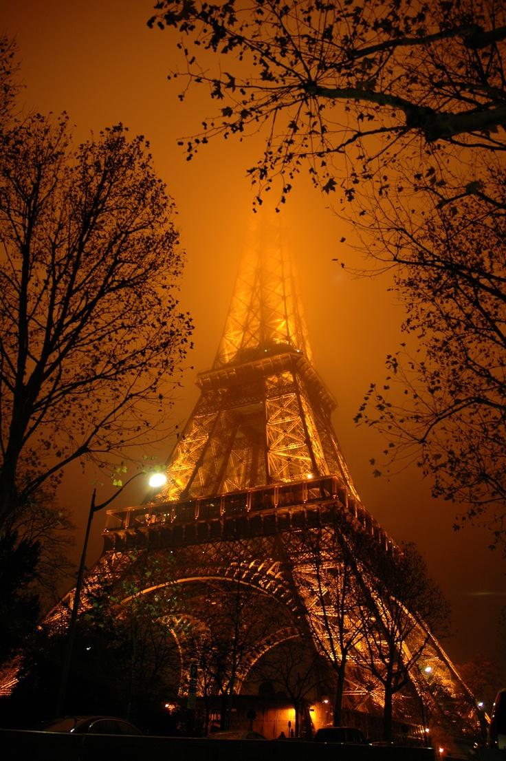 The Tour de Eiffel - or Eiffel Tower - on a foggy night.