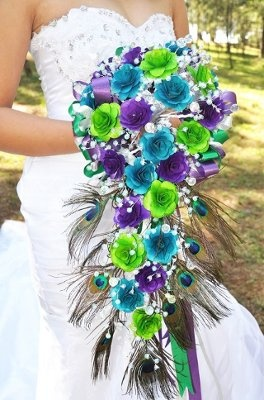 DIY bouquet with wooden flowers in Peacock colors and feathers. Love besides the peacock feathers lol