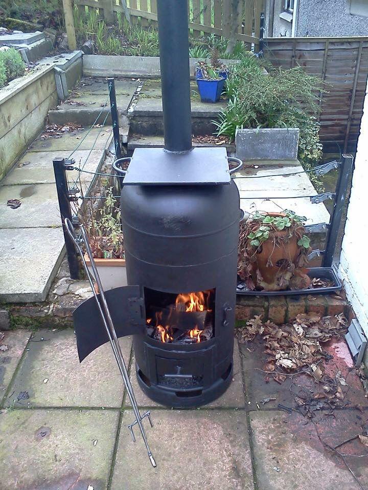 Gas bottle bbq wood burner with hot plate oefeningen for Rocket stove inside fireplace