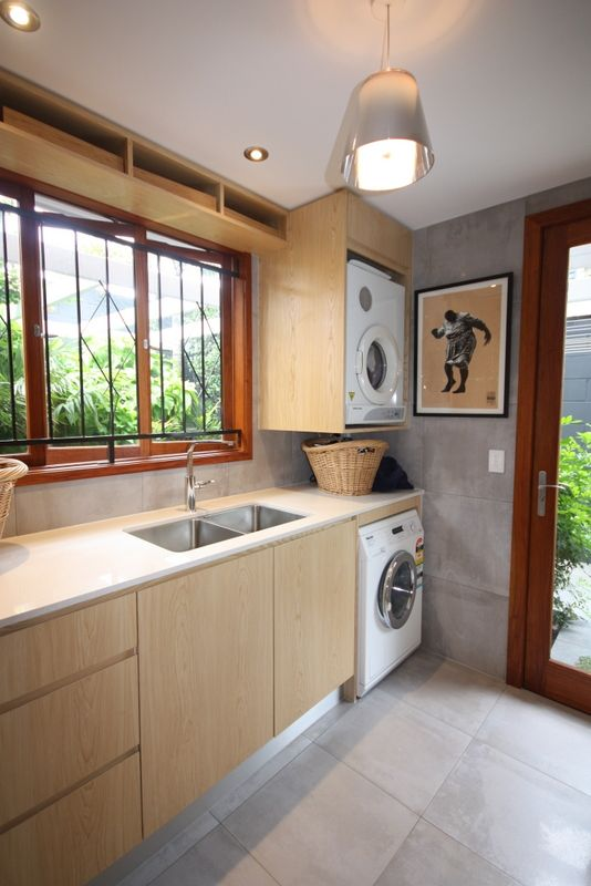 Laundry Renovation, Timber feature cabinetry, built in appliances, timber casement windows, undermount sink.