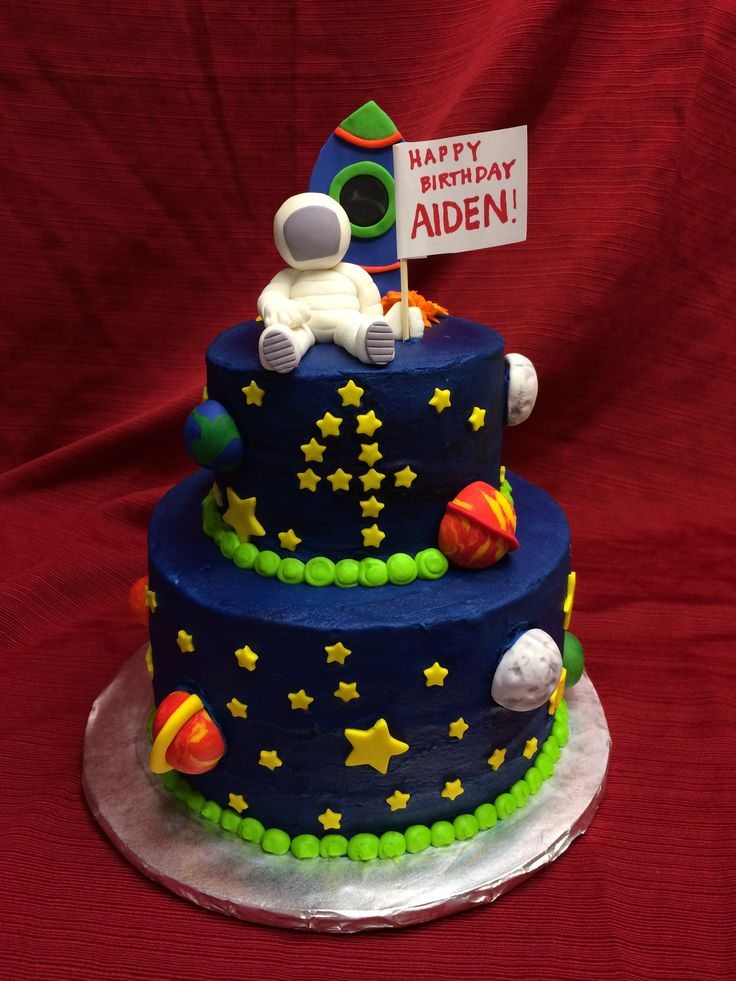 Space themed cake with astronaut and rocket.