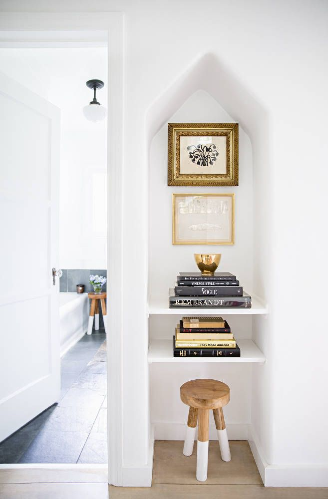 A cute nook built into the wall. Adds a great interest to any small space or hallway.