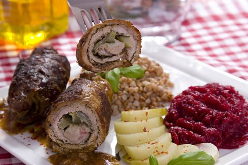 """Classic """"zrazy"""" have a rolled shape and are made of thin slices of beef, which is flavored with salt and pepper and stuffed with vegetables, mushrooms, eggs, and potato. However, there are numerous stuffing combinations as new ones are encouraged, such as pickles and bacon."""