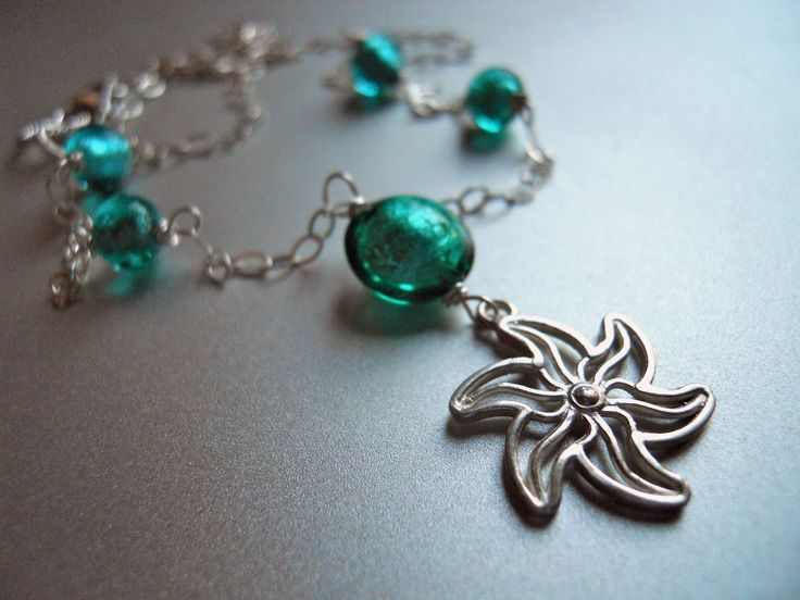 A Sterling Stella di mare, or Starfish in Italian, charm is combined with Murano glass in a beautiful bright apatite blue hue on a sterling chain. There are coordinating earrings available. This listing is for the necklace only. Your necklace will arrive beautifully giftboxed.
