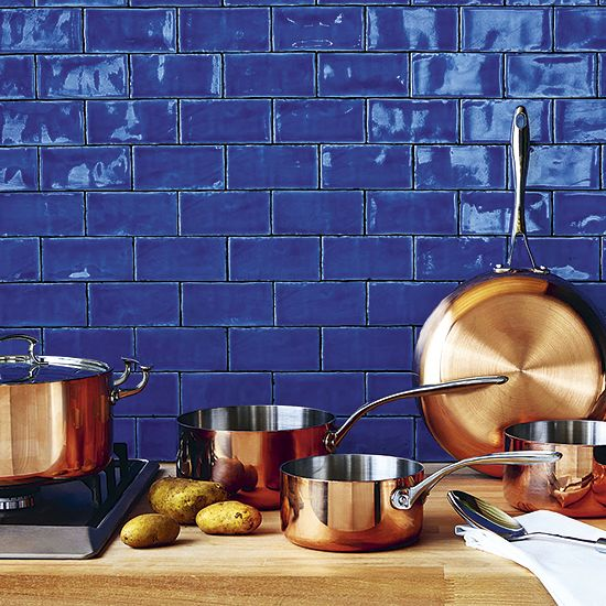 A great match: blue kitchen tiles and copper saucepans http://www.housetohome.co.uk/articles/blue-and-copper-kitchen-accessories_532605.html