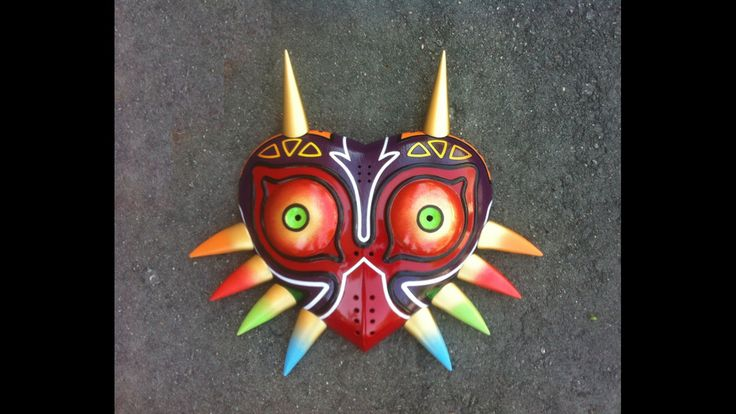 This mask is hand made and painted, The mask itself is made of fiberglass and the horns are 3d printed and later bolted to the shell.