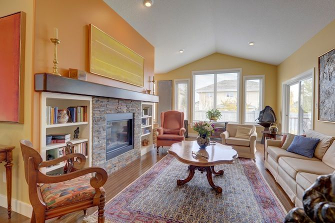 An over-reaching mantle, with hugging built-in shelves, adds addition depth to your loving fireplace.