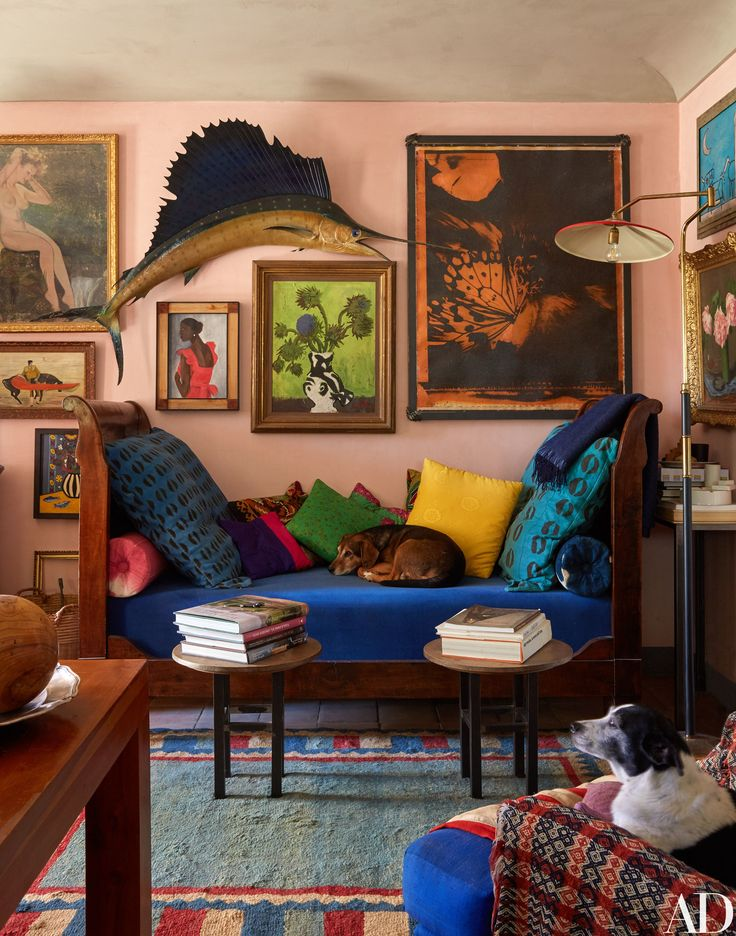 Photographer Oberto Gili's Dreamy Farmhouse in Northwest Italy. In the living room, a marlin leaps above a Cecil Beaton flower painting and an antique daybed. Photos | Architectural Digest