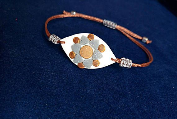Bohemian Evil Eye Bracelet in copper and gray colors. By Beejoujoux
