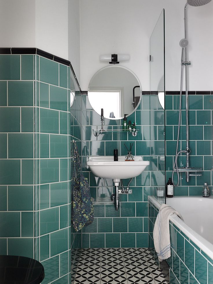 Bathroom with vintage-style green tiles