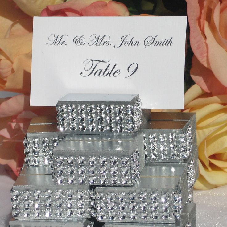 Silver Jeweled place card holders, the holder has been wrapped with a crystal wrap ribbon (please note: The crystal wrap does NOT include Real diamonds, crystals, or rhinestones, the gold stones just