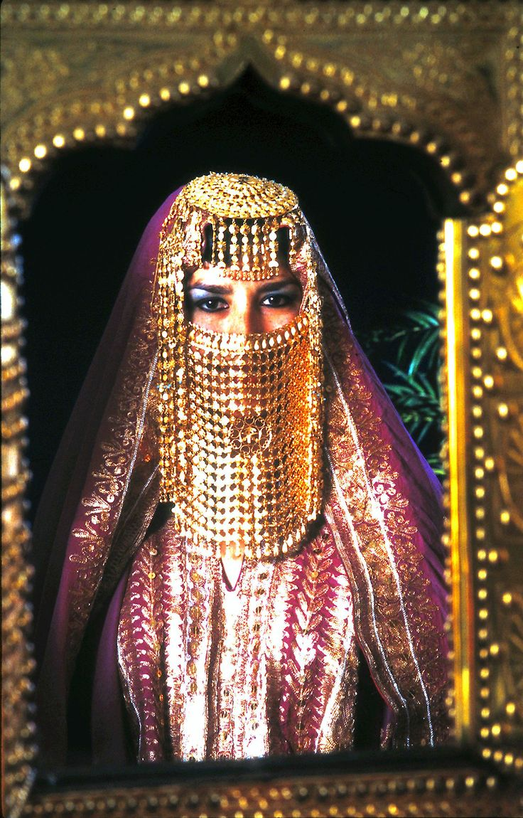 Saudi Arabia  Once the traditional bridal attire with Saudi gold and first look in antique mirror after the bride is prepared.by J.Lewis