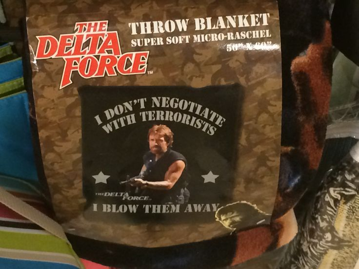 """At a store in the Rushmore Mall and found this throw blanket. I just imagine tossing this to granny on a long car ride, """"Here's your throw blanket with Chuck Norris saying, 'I don't negotiate with terrorists, I blow them away,' Gran..."""""""