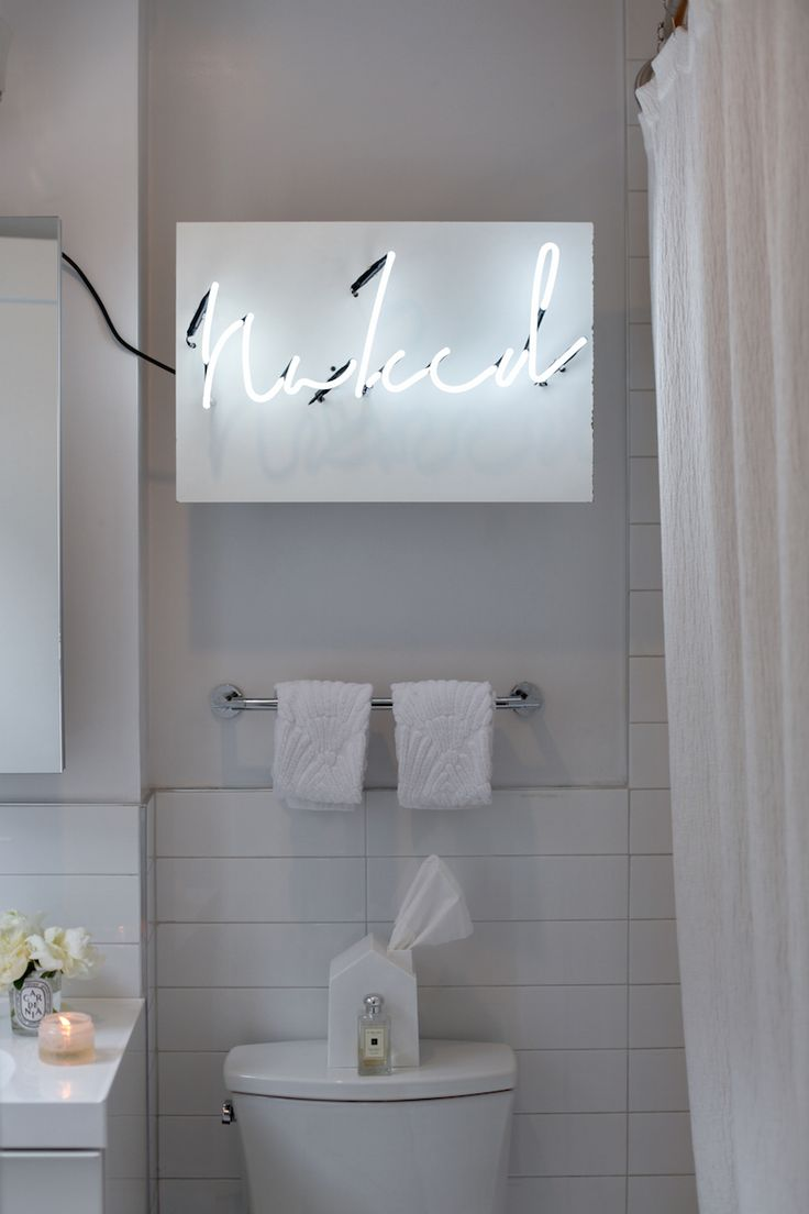 Francesca Falzone's NYC Apartment Tour  #theeverygirl // neon sign in the bathroom