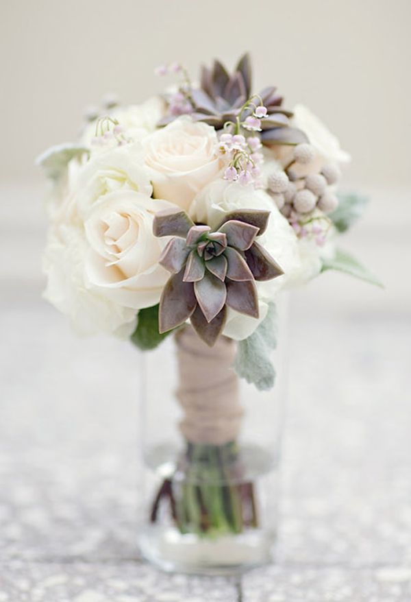 Love the subtle colors in this succulent and rose wedding bouquet. #wedding #flowers #succulents