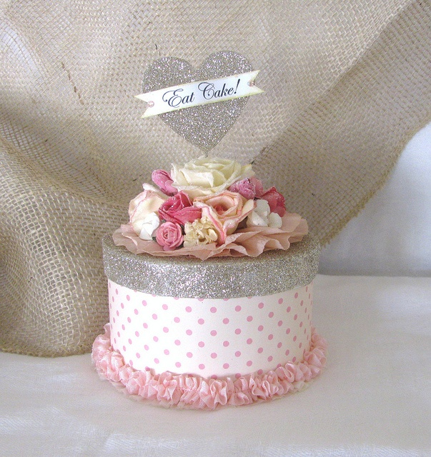 cute - I have been decorating old round cookie tins and using them for presents=)