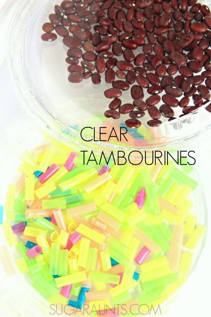 Clear tambouines made with recycled plastic plates and bright filler for sensory play.  Baby (and kids of all ages!) love these.