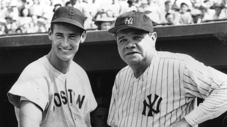 Ted Williams and Babe Ruth shake hands before a 1943 benefit game for the Red Cross.