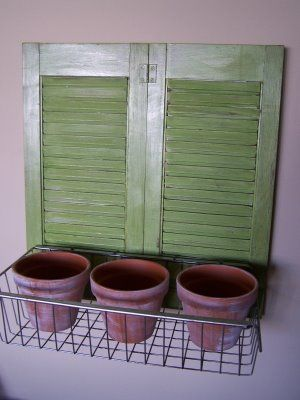 Shutters and window box, looks like a great indoor herb garden to me!