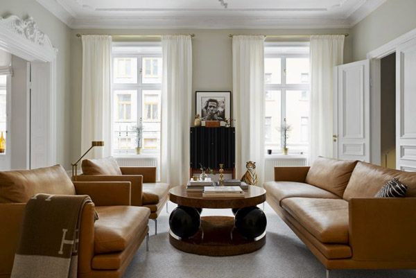 Tan leather sofa in the Art Deco inspired home of Sofia Wallenstam.