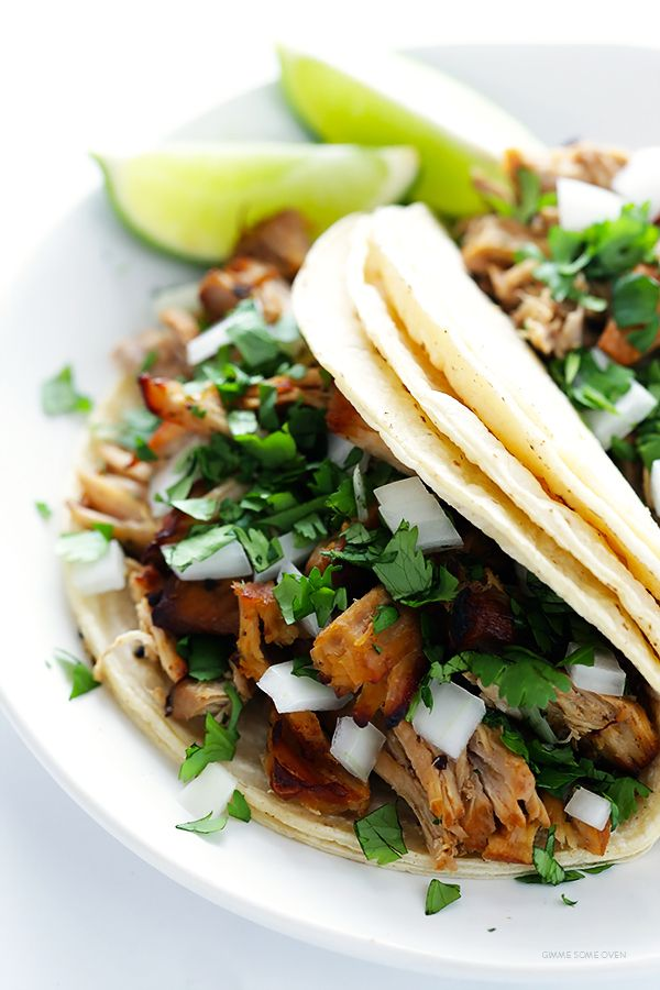 Crispy Slow Cooker Carnitas -- This favorite Mexican pork recipe is surprisingly easy to make in the crock pot, and it's perfectly tender, juicy, crispy, and SO delicious! Perfect for tacos, burritos, salads and more.   gimmesomeoven.com