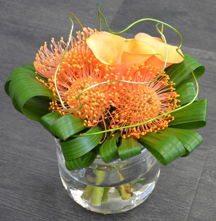 Leucospernums, Calla Lilies, Green Wire & Folded Palm Leaves